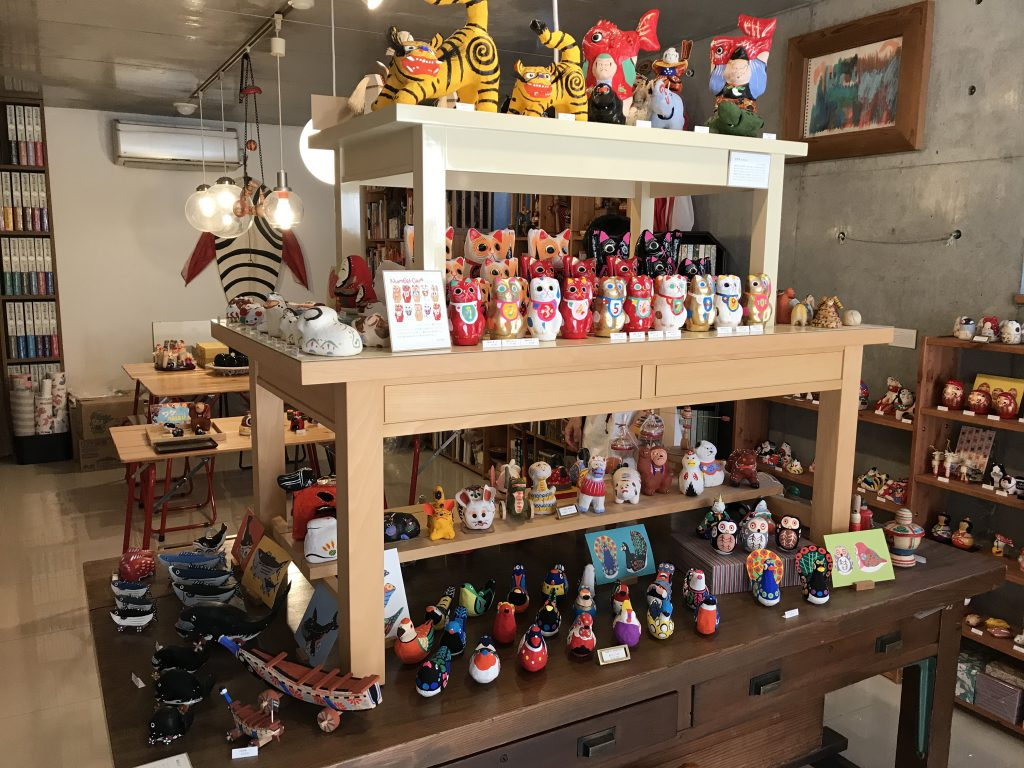 Lots of  colorful toys displayed on tables and shelves