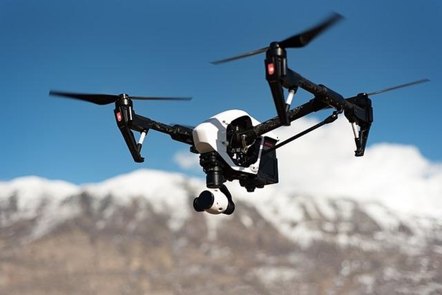 Drone flrying in front of a montain