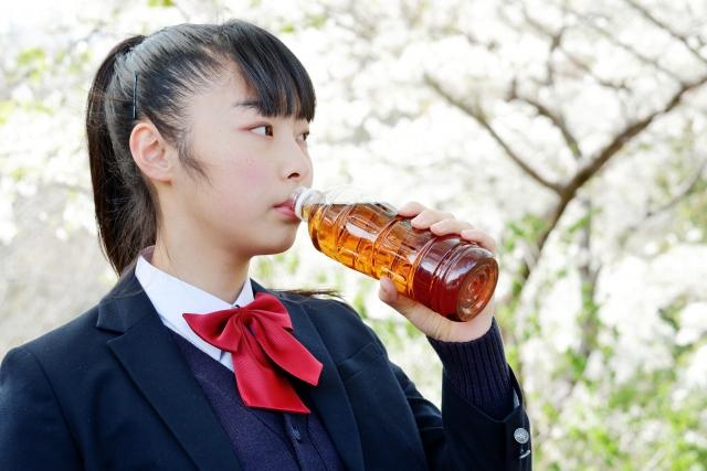 Japanese high school girl drinking mugicha