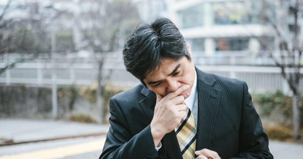 Older Japnese businessman thinking deeply