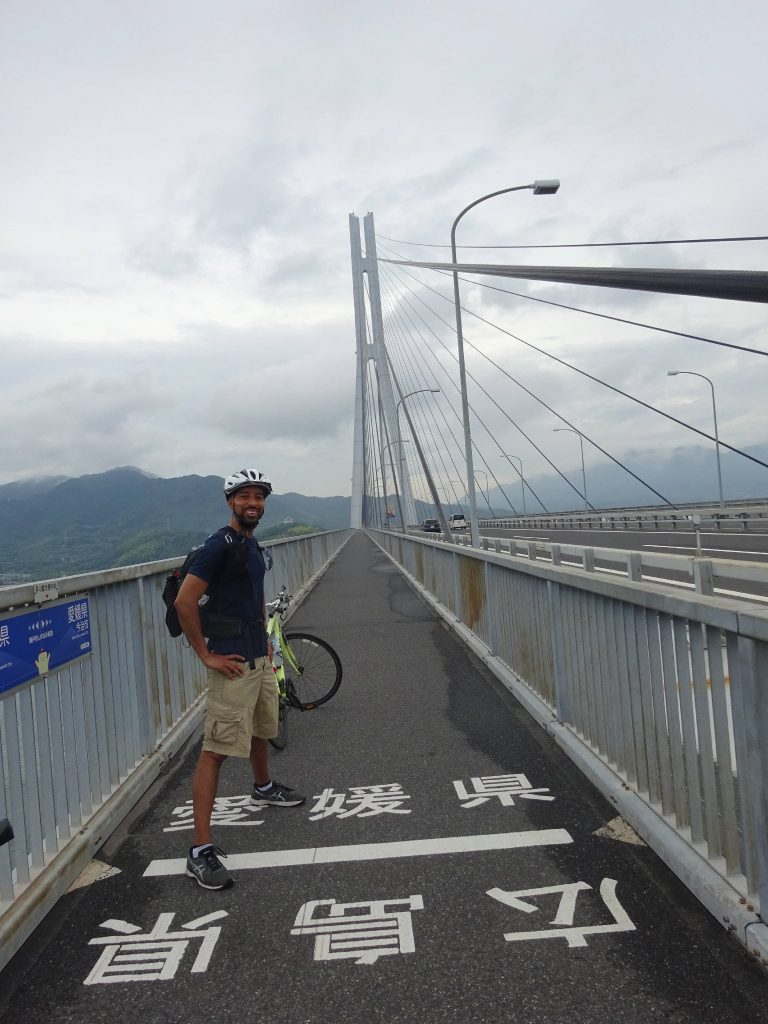 The author standing on a border line on a bridge
