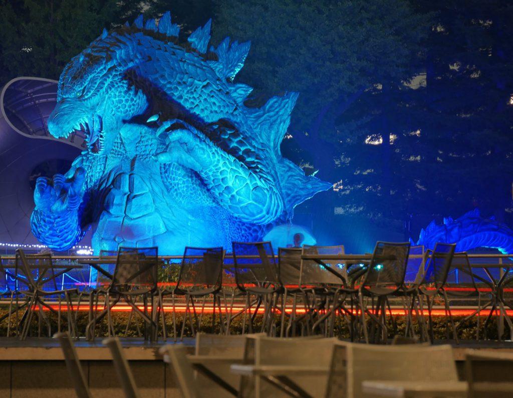 Huge Godzilla statue lighted in blue