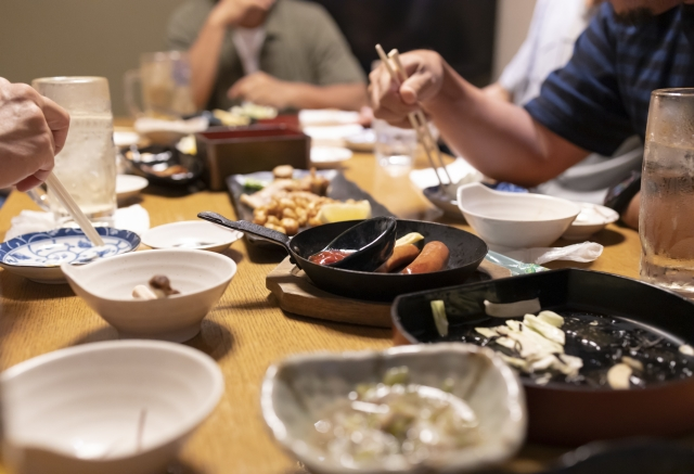 A Japanese tavern table with many shared dishes and small plates