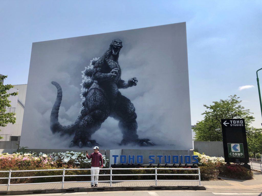 The entrance of Toho Studios marked by a huge Godzilla mural