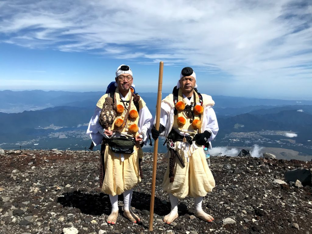 Two shugenja on top of Mount Fuji