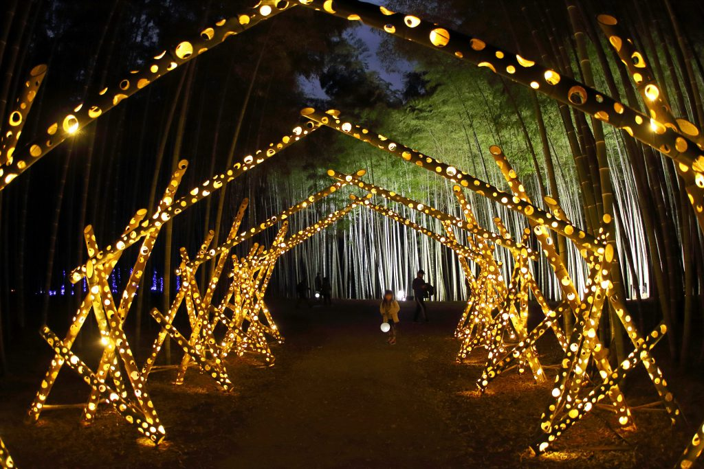 A tunnel made of lighted up carved bamboos