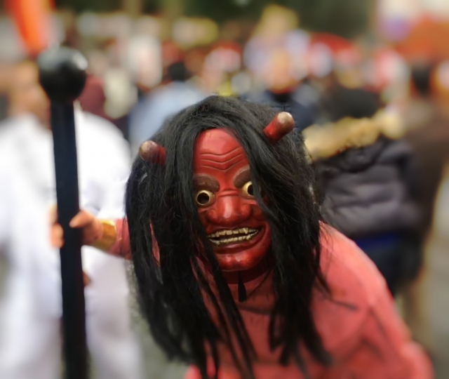 A Japanese demon fully covered in red