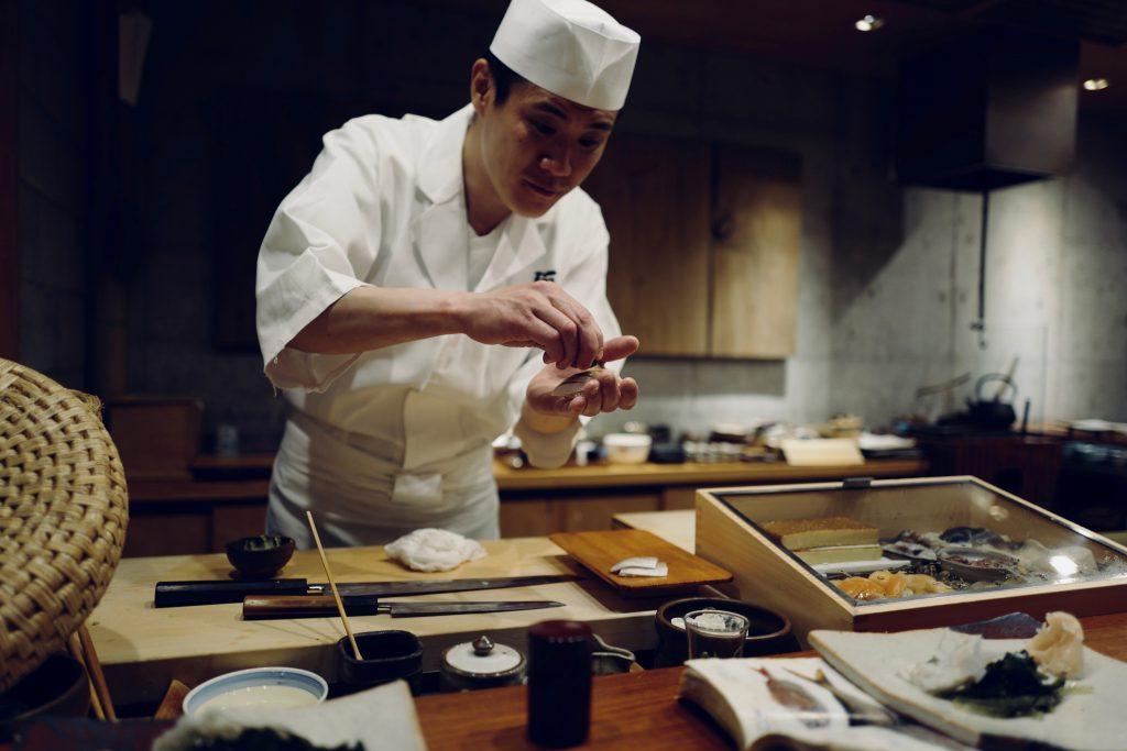 A Japanese sushi chef making sushi