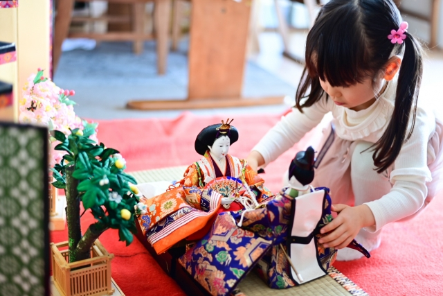 Japanese girls playing with porcelain dolls