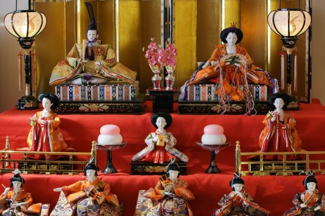 A three-tier display of hina dolls