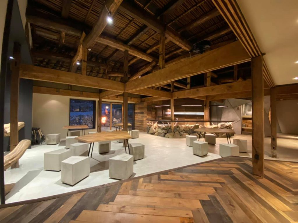 A spacious co-working space mostly made of wood and stone materials