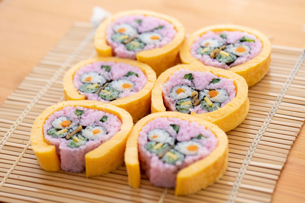 Butterfly-patterned big sushi rolls.