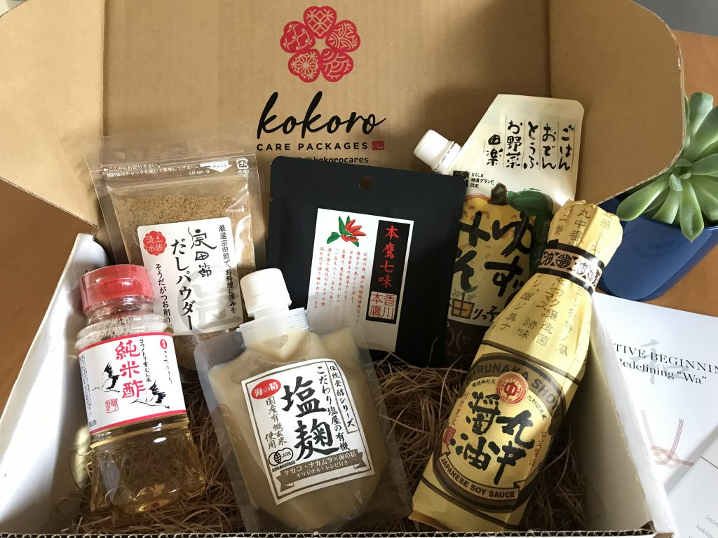 A box containing different sorts of Japanese seasonings