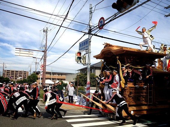Japanese men are pulling a huge wooden float