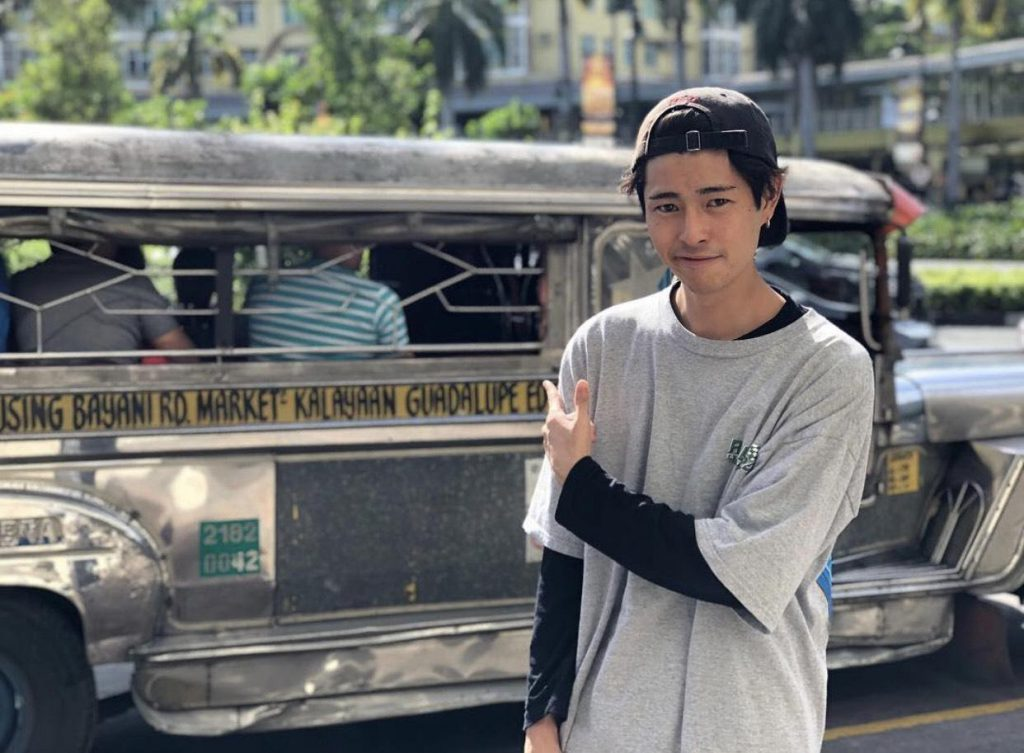 Fumiya in front of a Philippines bus