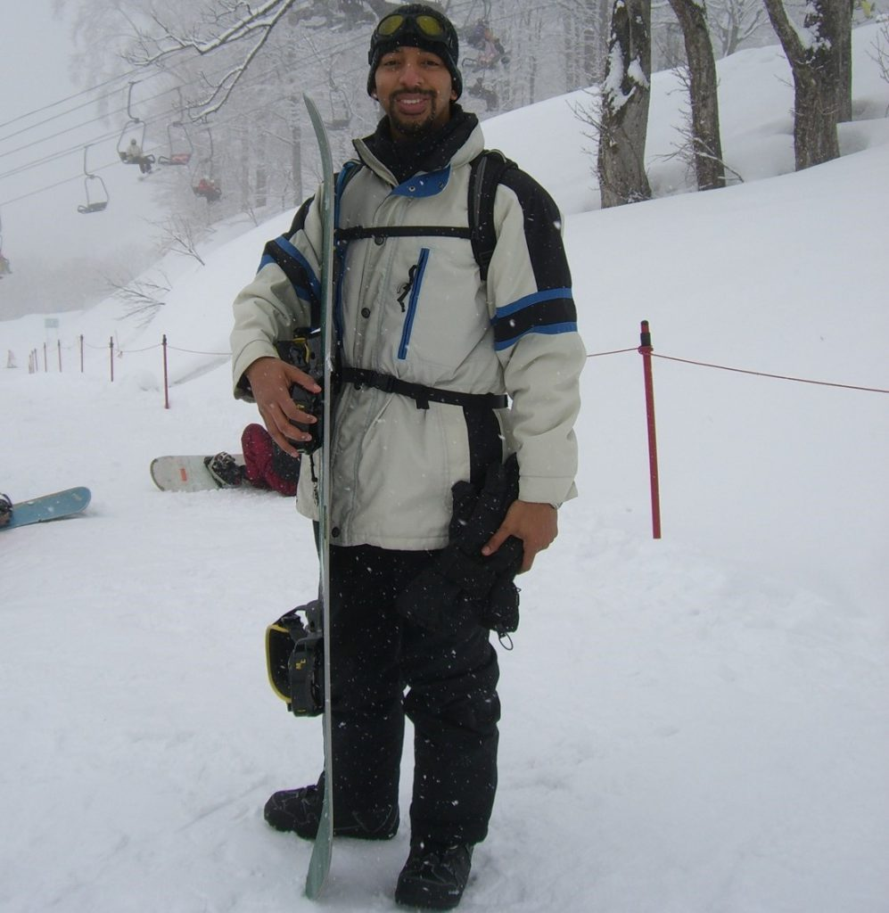 Anthony holding a snowboard