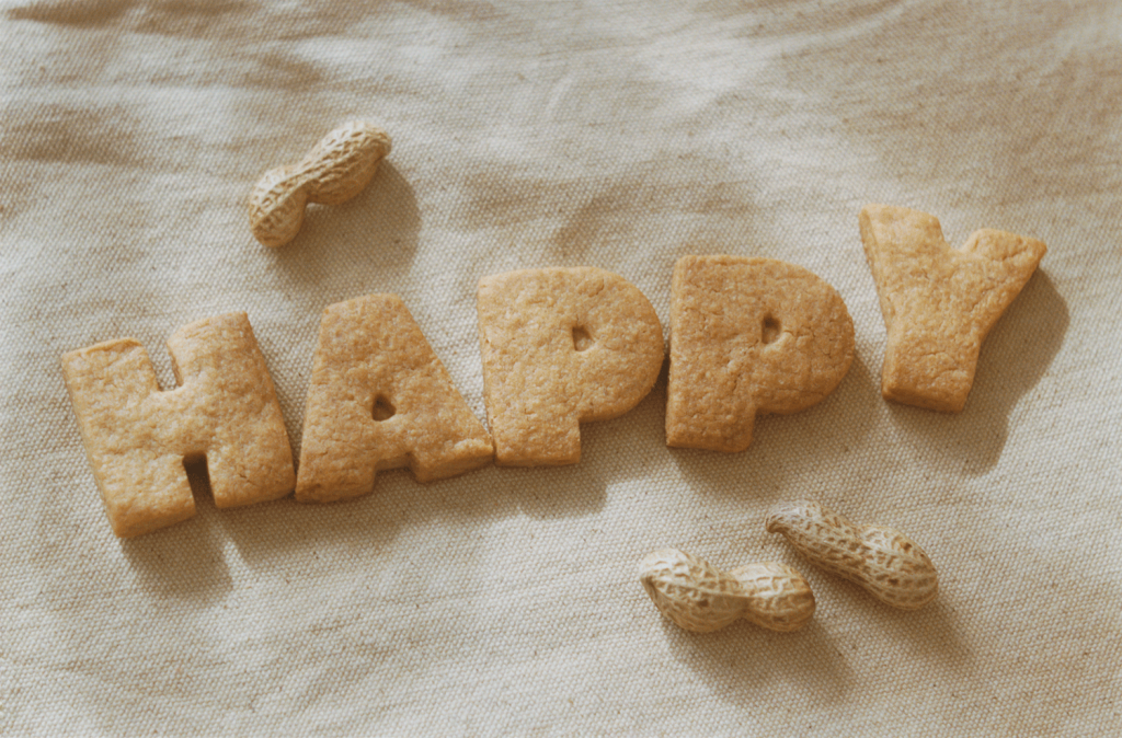 """Letter-shaped biscuits form the word """"happy"""""""