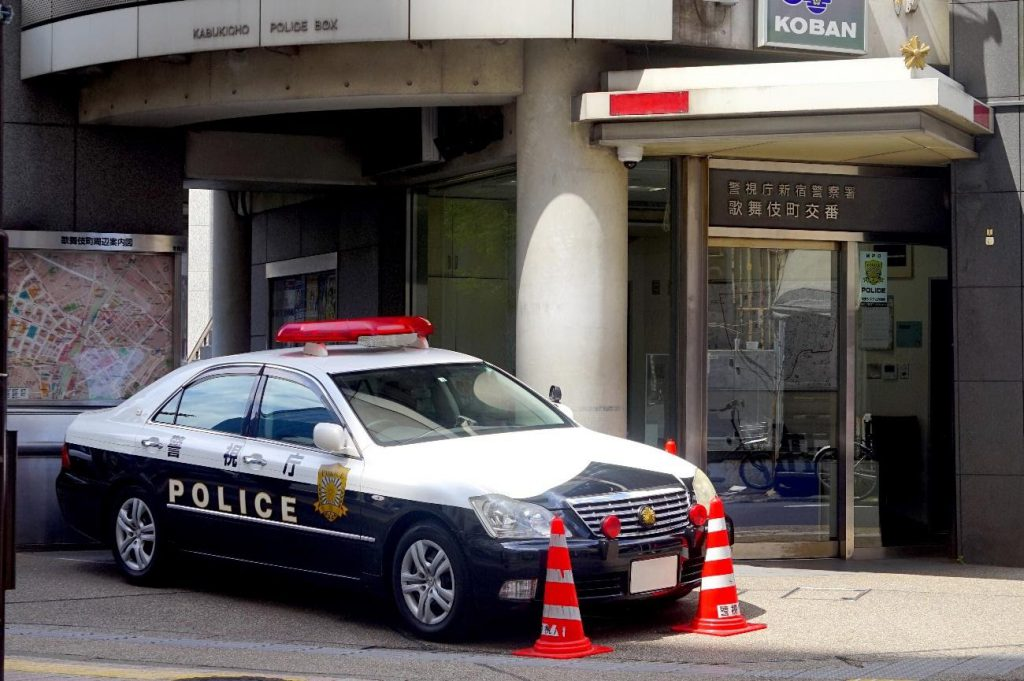 A police car in front of a Japanese police station